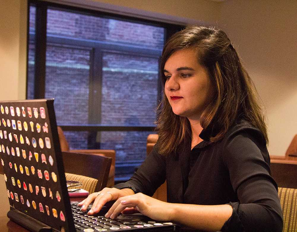 Senior Madison Mortell has been using her old Lenovo laptop since she started at Emersons journalism program. CASSANDRA MARTINEZ / BEACON STAFF