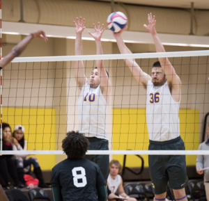 Team captain Nick Rusk (left) fired up his team after the second set. EZEKIEL LEVIN / BEACON STAFF