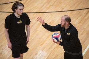 Head coach Ben Read instructs junior Mark Piorkowski at practice. Photo: Daniel Peden/Beacon Staff