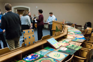 The cardboard mosaic will be installed in the State House from Jan. 29 to Feb. 2. Photo: Justin Scott Johnson / Beacon Staff