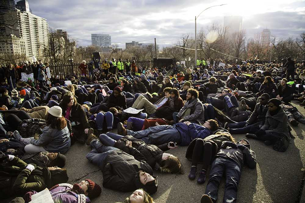 Protesters+marched%2C+chanted%2C+and+held+a+%22die-in%22+on+Martin+Luther+King+Jr.+Day+EVAN+WALSH+%2F+BEACON+STAFF%0A