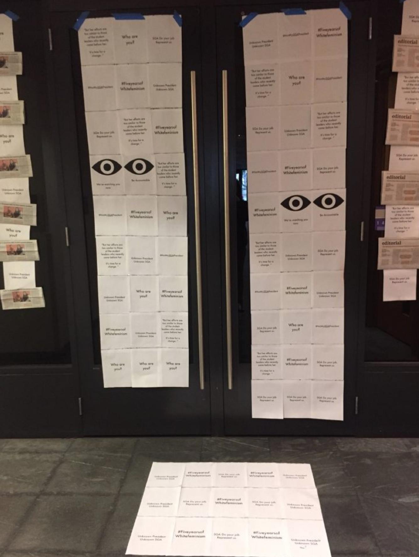 A display of posters hung on the door of the Multi-Purpose Room holding SGA accountable for a lack of visibility among students. Curtsey of The Student Government Association.