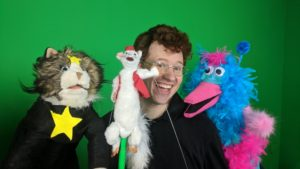 Pop goes the evil weasel in alum's puppet show