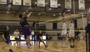 Win Kittivatcharapong (center, No.18) strikes a volley over the net. Photo by Kyle Bray / Beacon Staff