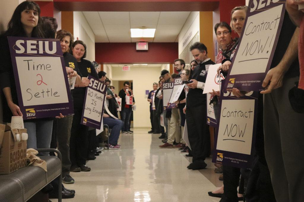 About 70 staff union members lined the hallway elbow-to-elbow on the lower level of the Max Mutchnick Campus Center while college administrators entered room L-151 for a contract negotiation with the union's bargaining committee in April. Chris Van Buskirk / Beacon Archive.