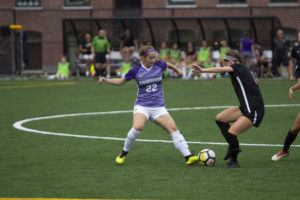 Jenna Case (No. 22) challenges for the ball in Emerson's 1-0 victory over Wesleyan. Photo: Kyle Bray/Beacon Staff.