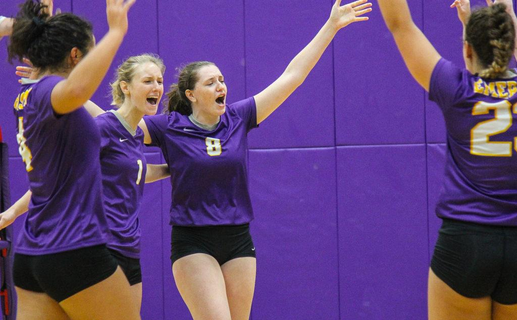 Junior captain Grace Tepper (center, No. 8) leads the NEWMAC in kills and kills per game. Anissa Gardizy / Beacon Staff