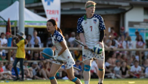 Tyler Trudeau (right, No.7) stands alongside teammate Xu Lulu in a 2018 IQA World Cup match. Photo courtesy of Miguel Esparza/USA Quidditch.