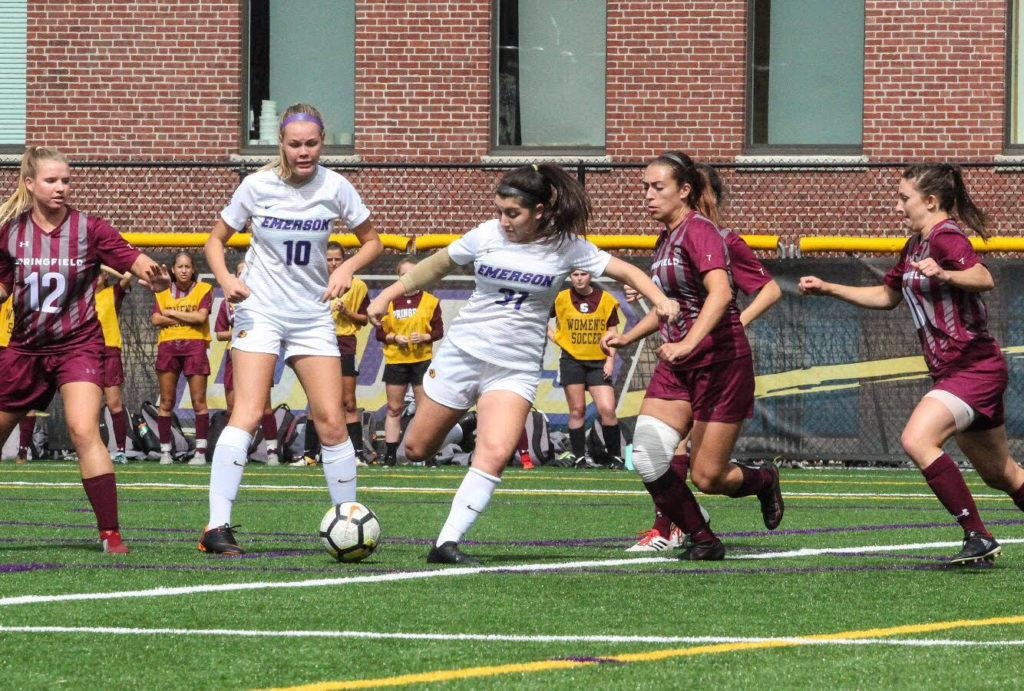 Kayla McNamara (No. 31, center) scores her first ever collegiate goal in Emersons 2-1 loss to Sprinngfield. Photo: Anissa Gardizy/Beacon Corresponndent.
