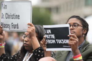 Morgan Payne (left), a senior at Texas Southern University, joined in on the silent protest at Sen. Jeff Flake's panel discussion. Cullen Granzen / Beacon Staff