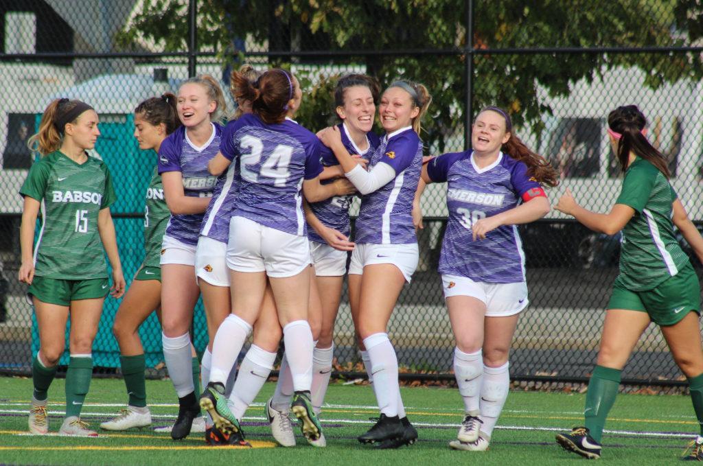 The women's soccer team celebrates senior Kira Venturini's opening goal on senior day. Photo by Anissa Gardizy / Beacon Staff