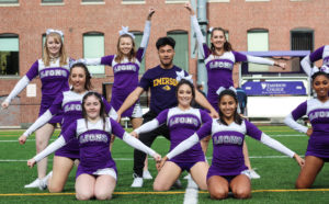 Ryan Rinaldi (center) poses with the Emerson Cheer Squad after finishing a routine. Photo by Anissa Gardizy / Beacon Staff