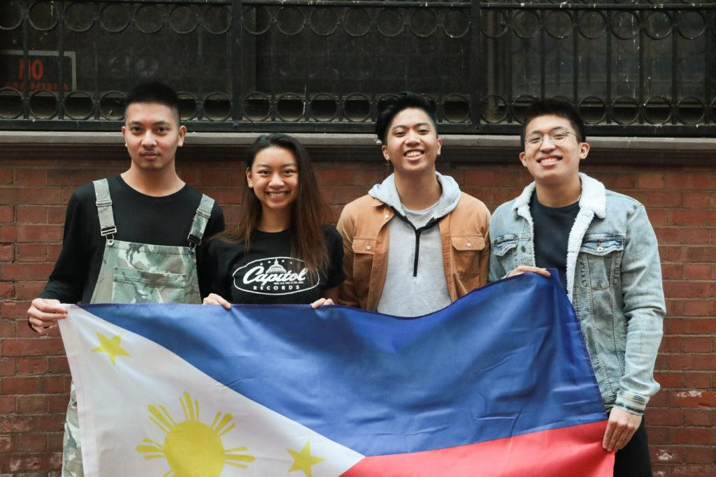 From+left%2C+Alfonso+Mateo%2C+Bianca+Nicdao%2C+Francis+De+Leon%2C+and+Ranton+Andaya+hold+up+the+Filipino+flag+for+their+documentary+about+the+country%27s+culture.+Photo+by+Tivara+Tanudjaja+%2F+Beacon+Correspondent