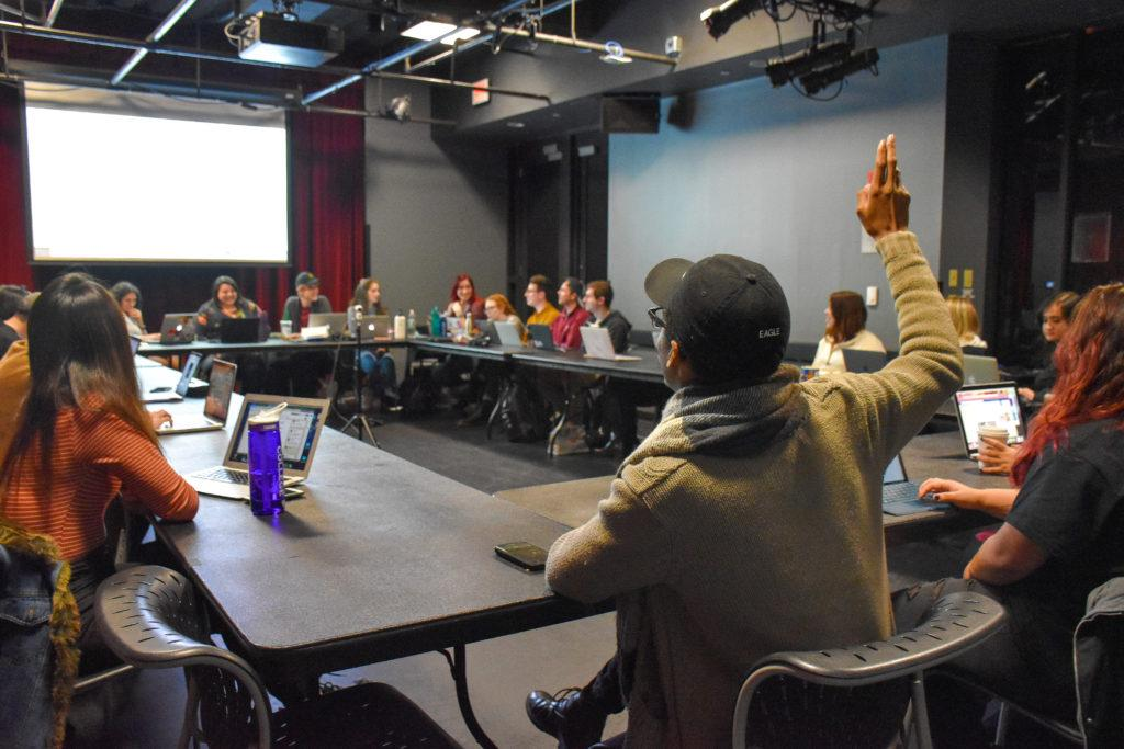 Elections+Chair+Christopher+Henderson-West+raises+his+hand+to+ask+a+question+at+the+Nov.+13+meeting.+Anissa+Gardizy+%2F+Beacon+Staff