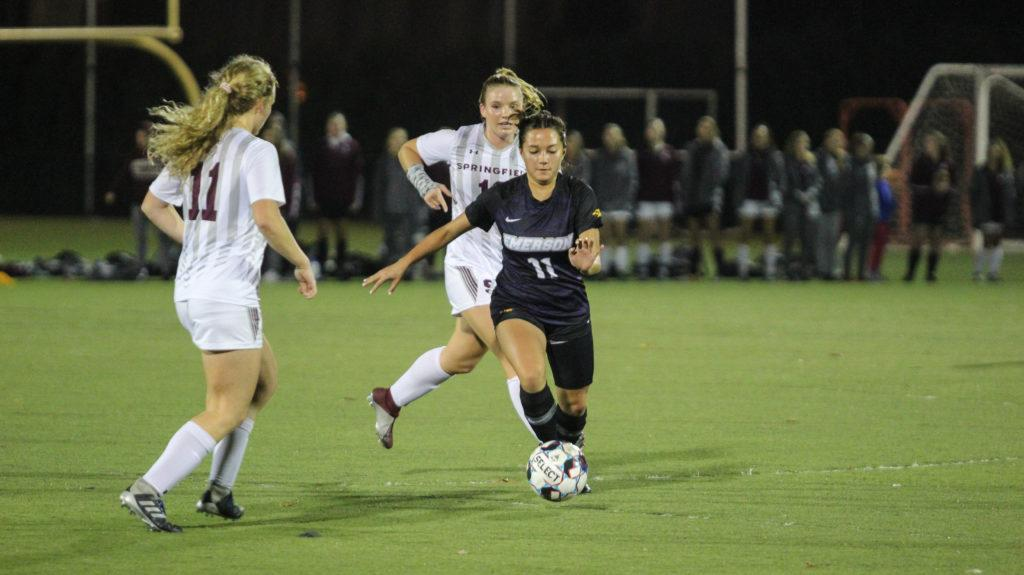 Veronica Alberts (No. 11) takes on two Springfield defenders. Photo by Anissa Gardizy / Beacon Staff