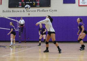 Freshman Lauren Quan prepares to hit the ball. Photo by Anissa Gardizy / Beacon Staff