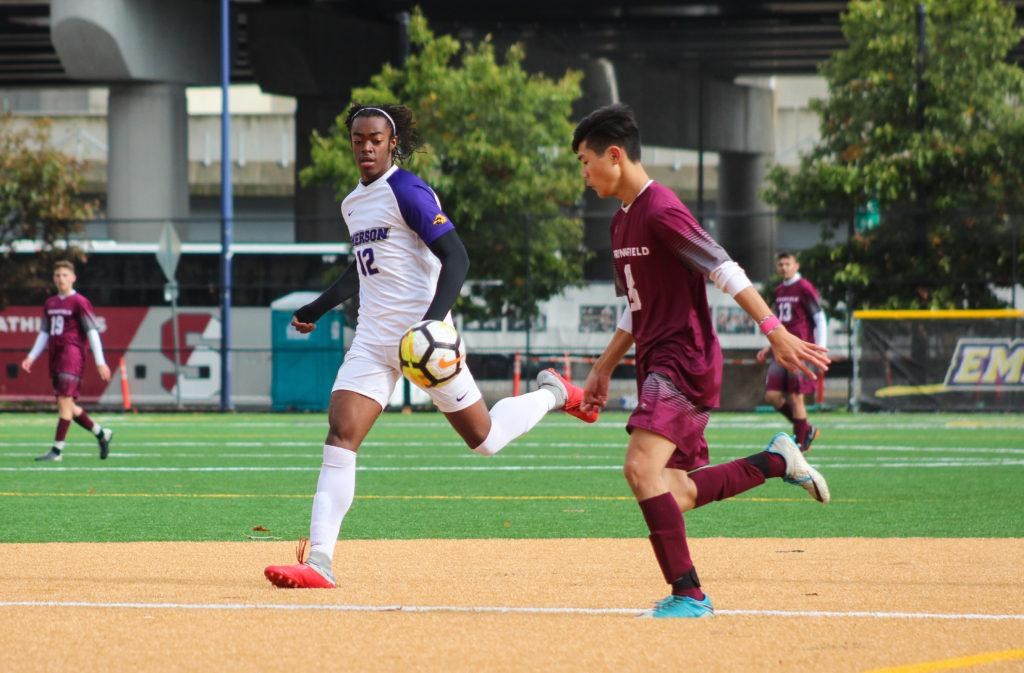 Freshman Darius Boamah chases down the ball against Springfield. Photo by Anissa Gardizy / Beacon Staff