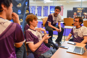 The Emerson College Esports 'Overwatch' team strategizes ahead of its matchup with Northeastern on Dec. 8. Photo by Anissa Gardizy / Beacon Staff