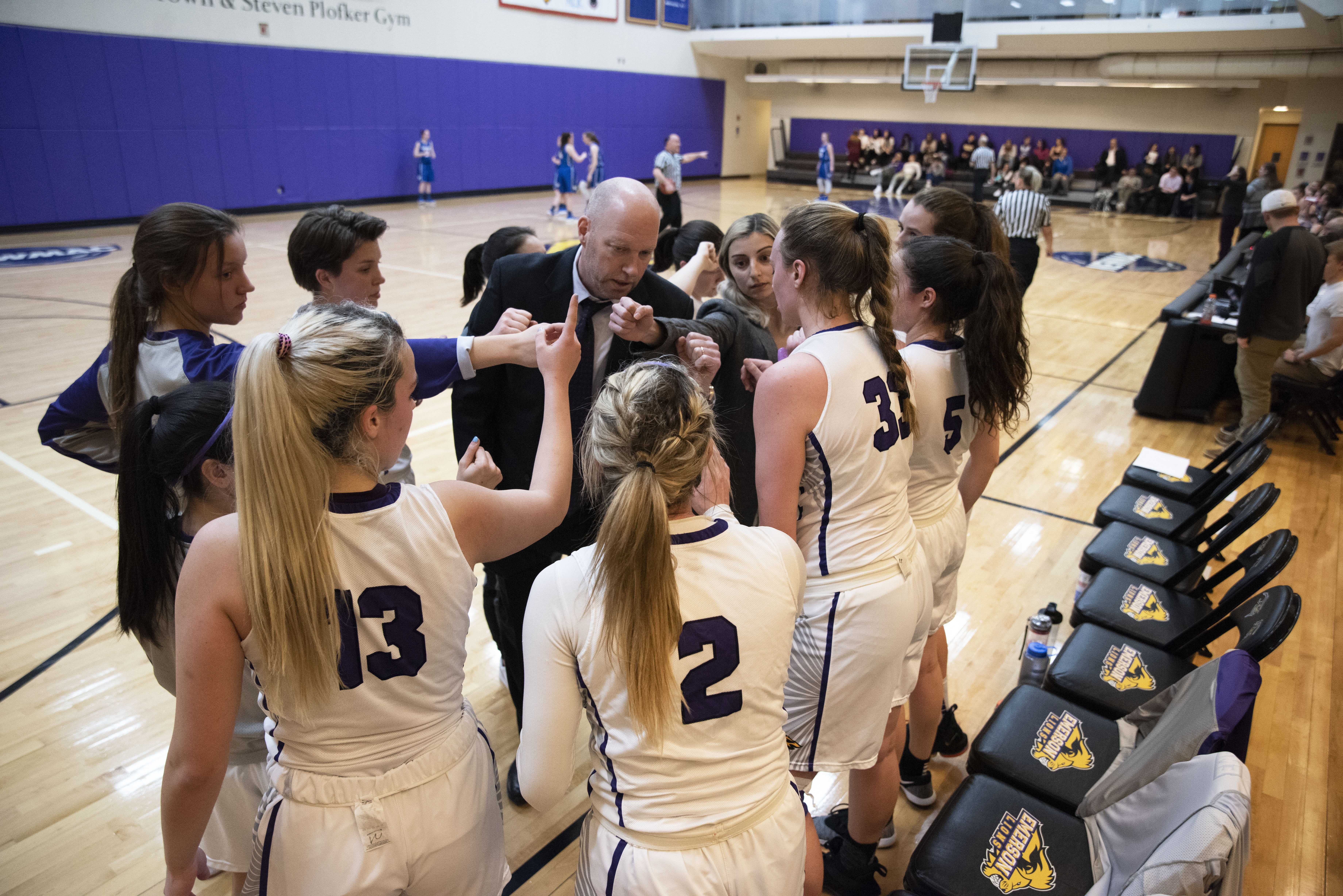 The Lions huddle before tip off in a game against Wheaton on Jan. 23. Photo by Daniel Peden / Beacon Staff