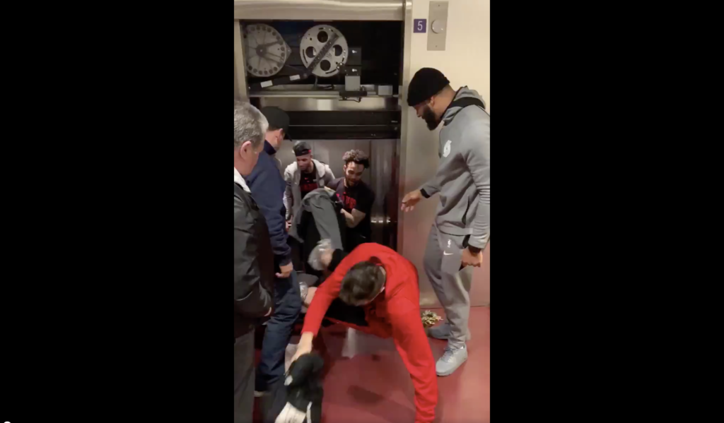 Members of the Portland Trail Blazers climb out of a Piano Row elevator. Photo by @meyersleonard11/Twitter