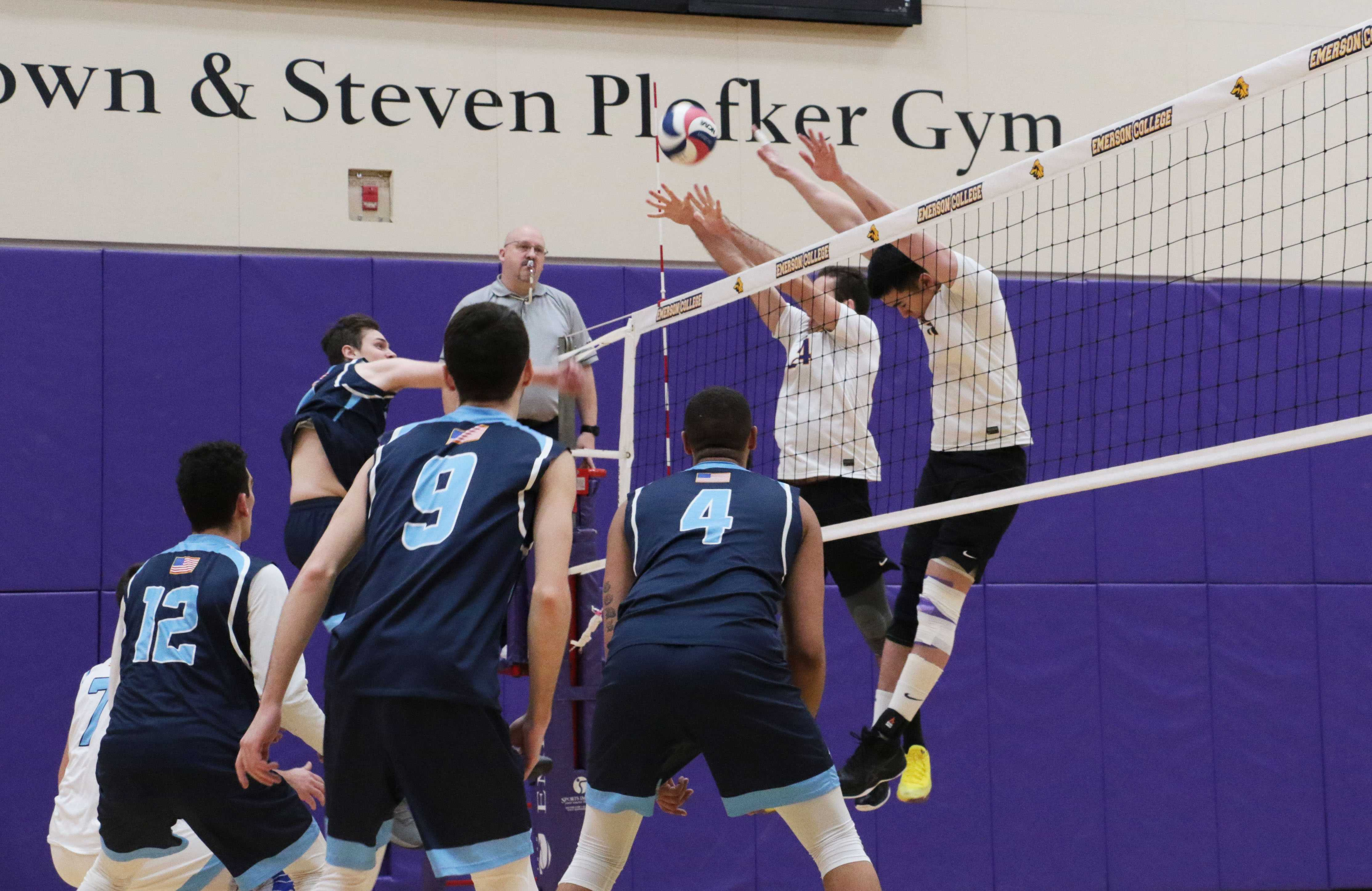 Sophomore Samuel Willinger (in white, left) and Senior Win Kittivatcharapong (in white, right) block an attack from Lasell. Photo by Tivara Tanudjaja / Beacon Correspondent