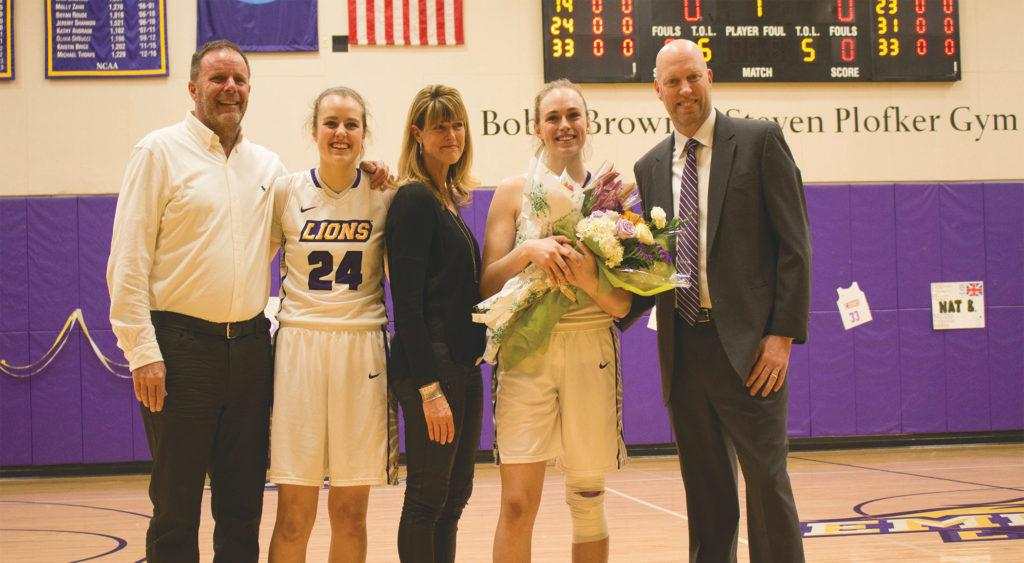 Senior+Charlie+Boyle+%28second+from+right%29+is+accompanied+by+her+parents+and+sister%2C+%28second+from+left%29+sophomore+Sam+Boyle%2C+during+her+senior+day+celebration.+Photo+by+Maia+Sperber+%2F+Beacon+Staff+