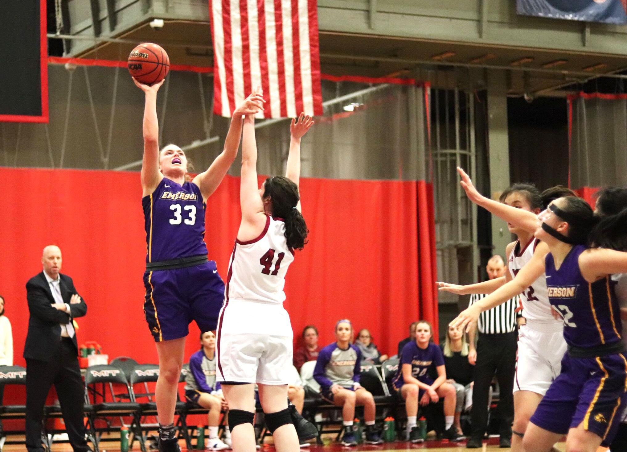 Senior Charlie Boyle (left, No. 33) goes up for a layup and senior Natalie Busch (right, No. 12) waits for the rebound in the NEWMAC quarterfinals against MIT. Photo by Arturo Ruiz / Beacon Correspondent