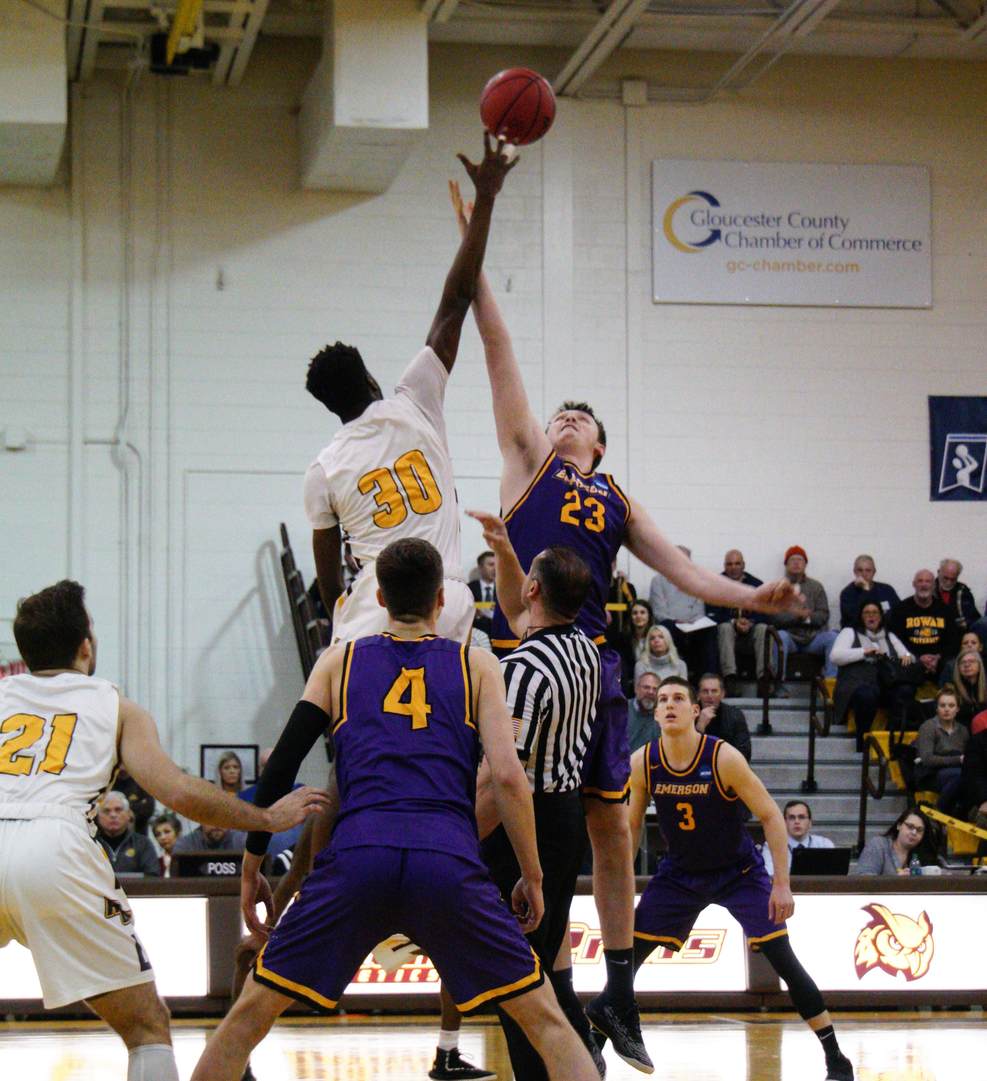 Freshman Jarred Houston (center, No. 23) rises up for two of his 12 points against Rowan University. Photo courtesy of The Whit