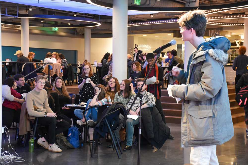Members of SGA watch as freshman Brady Baca gives an impassioned speech during spring election press night two days before announcing his departure from the executive treasurer's race. Anissa Gardizy / Beacon Staff