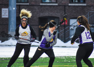 The women's lacrosse team lost in its first game of the season 13-6 against Becker College. Photo by Abbey Finn / Beacon Correpondent