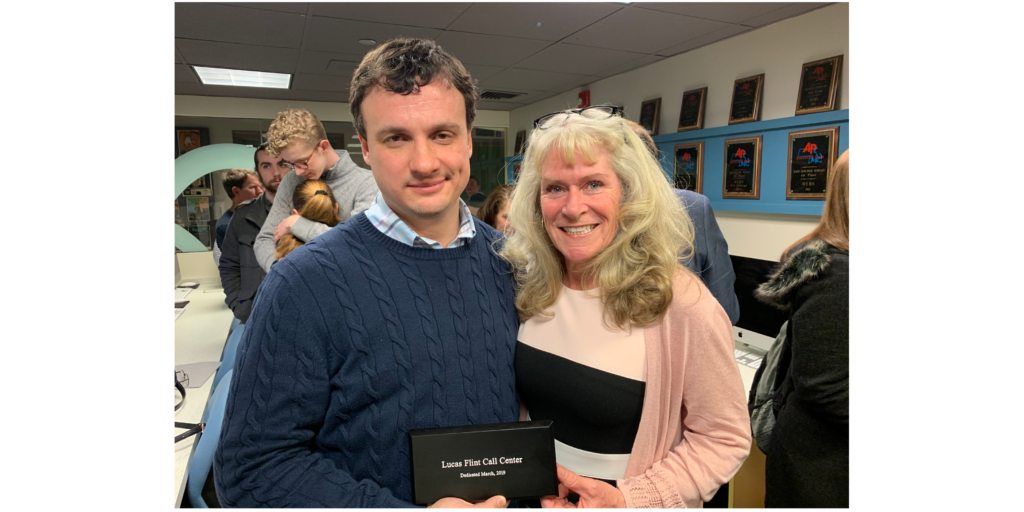 Kevin Cooney, director of development at WERS, dedicated the WERS call center to late Emerson student Lucas Flint with Flint's mother Susan in attendance. Abigail Hadfield / Beacon Staff