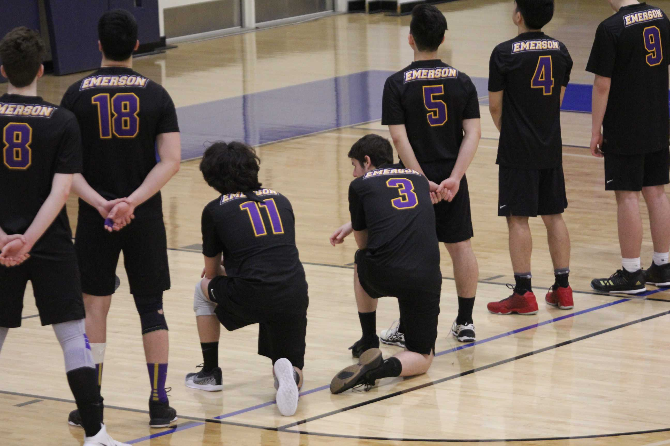 Max Weltz (No. 3) joined Lucas Raagas (No. 11) in kneeling during the Anthem this season. Photo by Aaron J. Miller / Beacon Staff