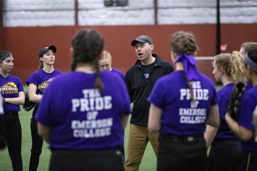 Softball head coach Phil McElroy (center) is one of many coaches who developed an online recruiting approach.