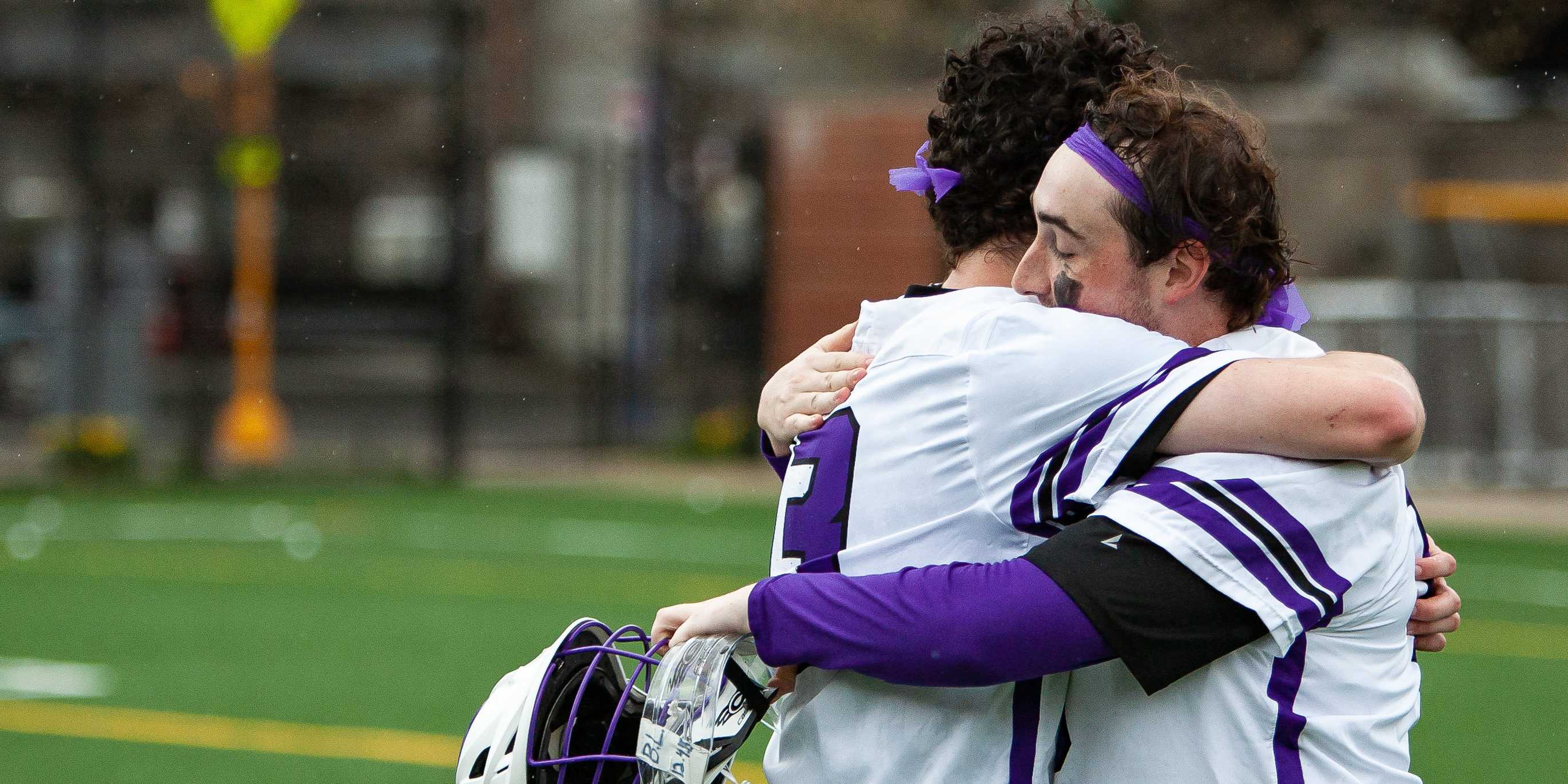 Freshman goalie Malcolm McGrath (left) hugs senior goalie Bailey Kennedy (right) after the men's lacrosse team's first conference win since 2013. Photo courtesy of Kate Foultz.