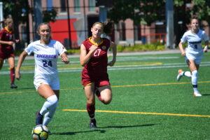 Freshman midfielder Ainslee MacQuarrie (left, No. 24) scored the opening goal in the Lions' home opener against Regis College. Photo by Carol Rangel / Beacon Photographer