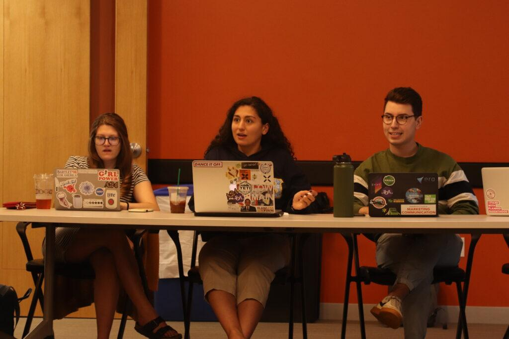 Abigail Semple (left), Raz Moayed (middle), and Will Palauskas (right) discuss Semple's policy proposal at joint session. Christopher Van Buskirk / Beacon Staff