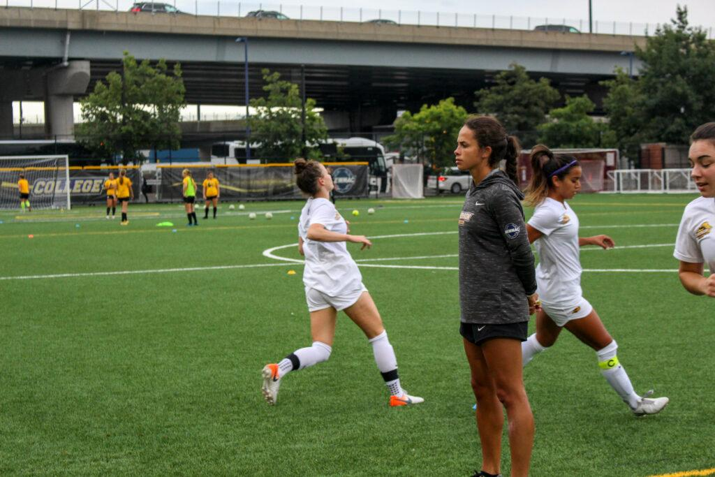 Assistant coach Kayla Cappuzzo (center) joined the team during the off season. Montse Landeros / Beacon Correspondent