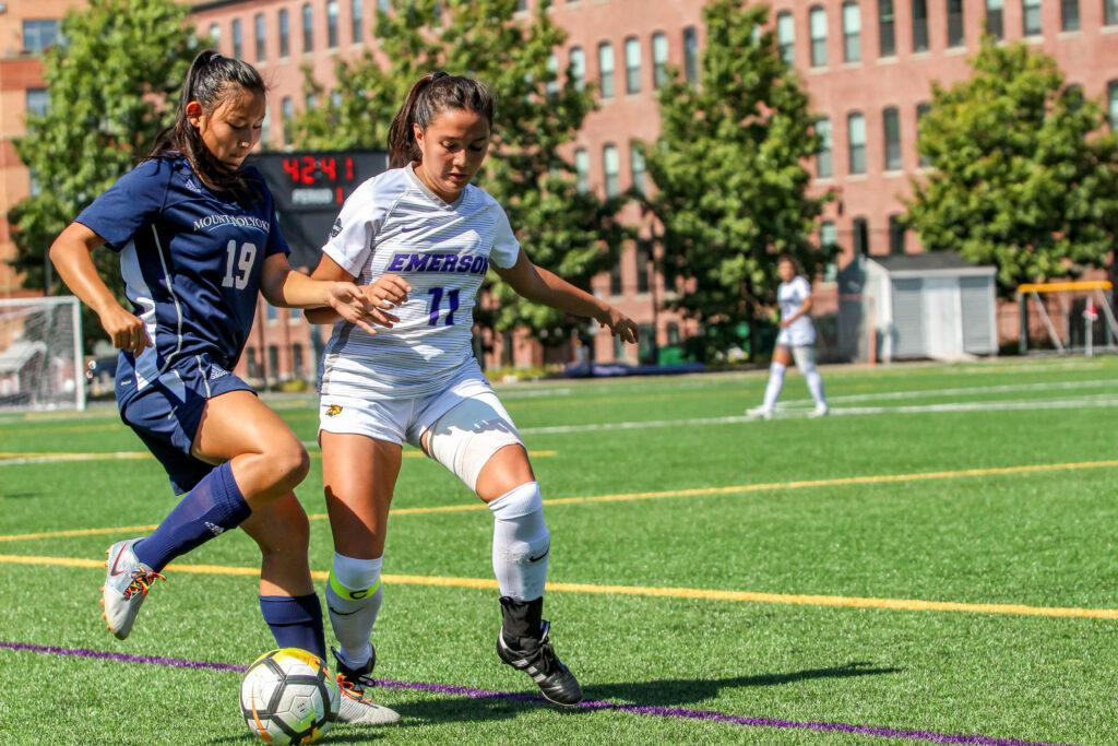 Senior Veronica Alberts (right, No. 11) totaled two shots on goal and one assist in the team's win against Mount Holyoke. Montse Landeros / Beacon Correspondent