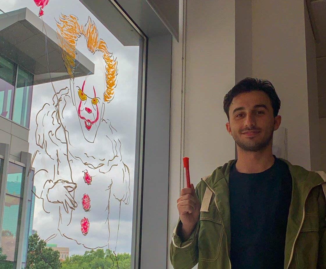 Senior Joe Scardilli grew up drawing—now he works for the SEAL office sketching memes on the new walls of 172 Tremont St. Courtesy of Joe Scardilli