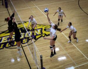 Junior outside hitter Grace Tepper spikes the ball over the net. Rachel Culver / Beacon Staff