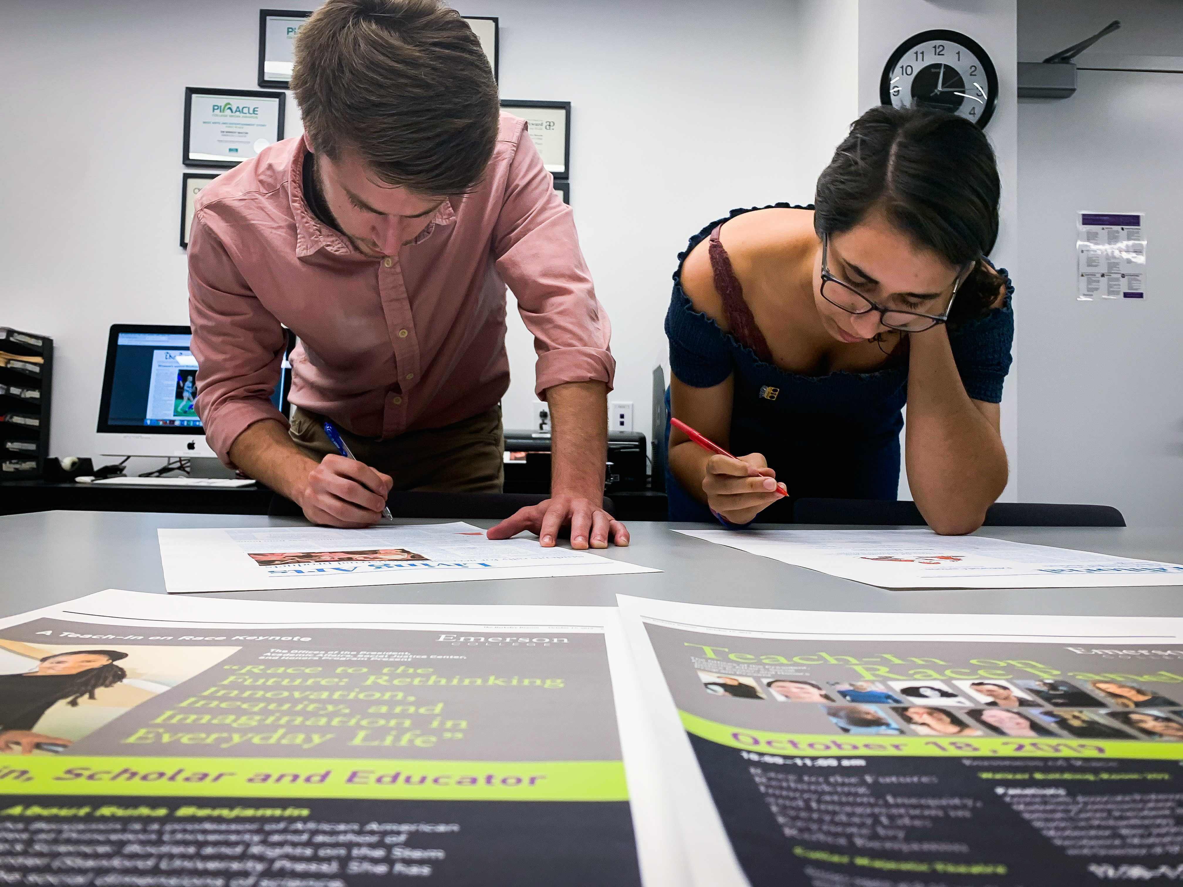 Editor-in-Chief Chris Van Buskirk and Copy Managing Editor Abigail Hadfield proof the final version of The Beacon before sending it to print.