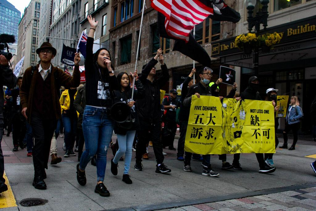 Senior+Frances+Hui+leads+dozens+through+Boston+in+a+pro-Hong+Kong+march+on+Saturday.+Rachel+Lo+%2F+Beacon+Staff