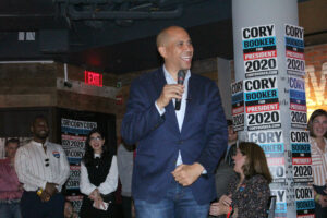Booker talks gun control, student debt at Fenway campaign event