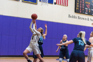 Senior Natalie Clydesdale (No. 2) drives towards the basket for a layup. Greyson Acquaviva / Beacon Staff