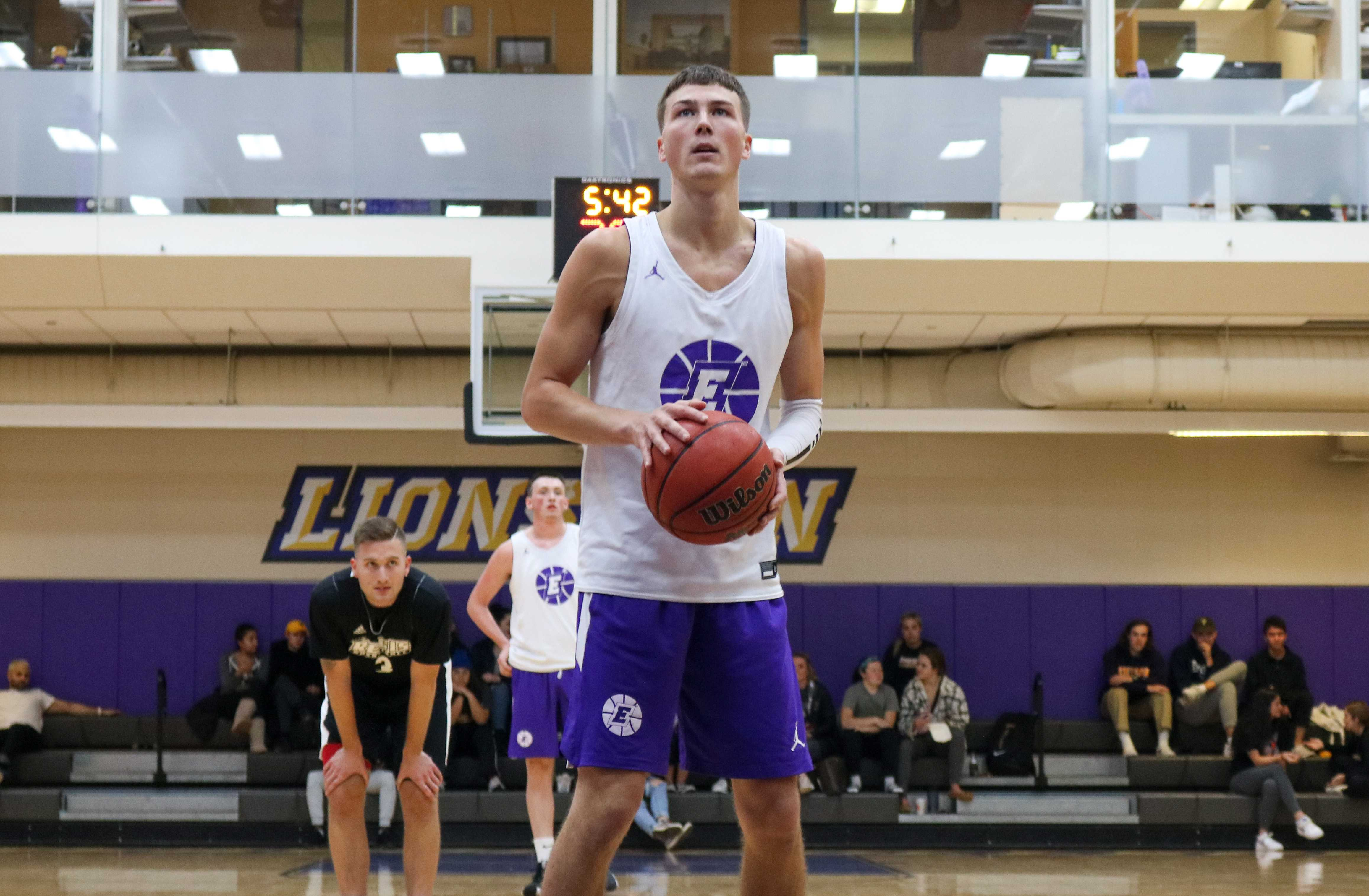 Senior Jack O'Connor scored 17 points with 40 percent shooting from the field in the Lions' scrimmage against Regis College. Aaron J. Miller / Beacon Staff
