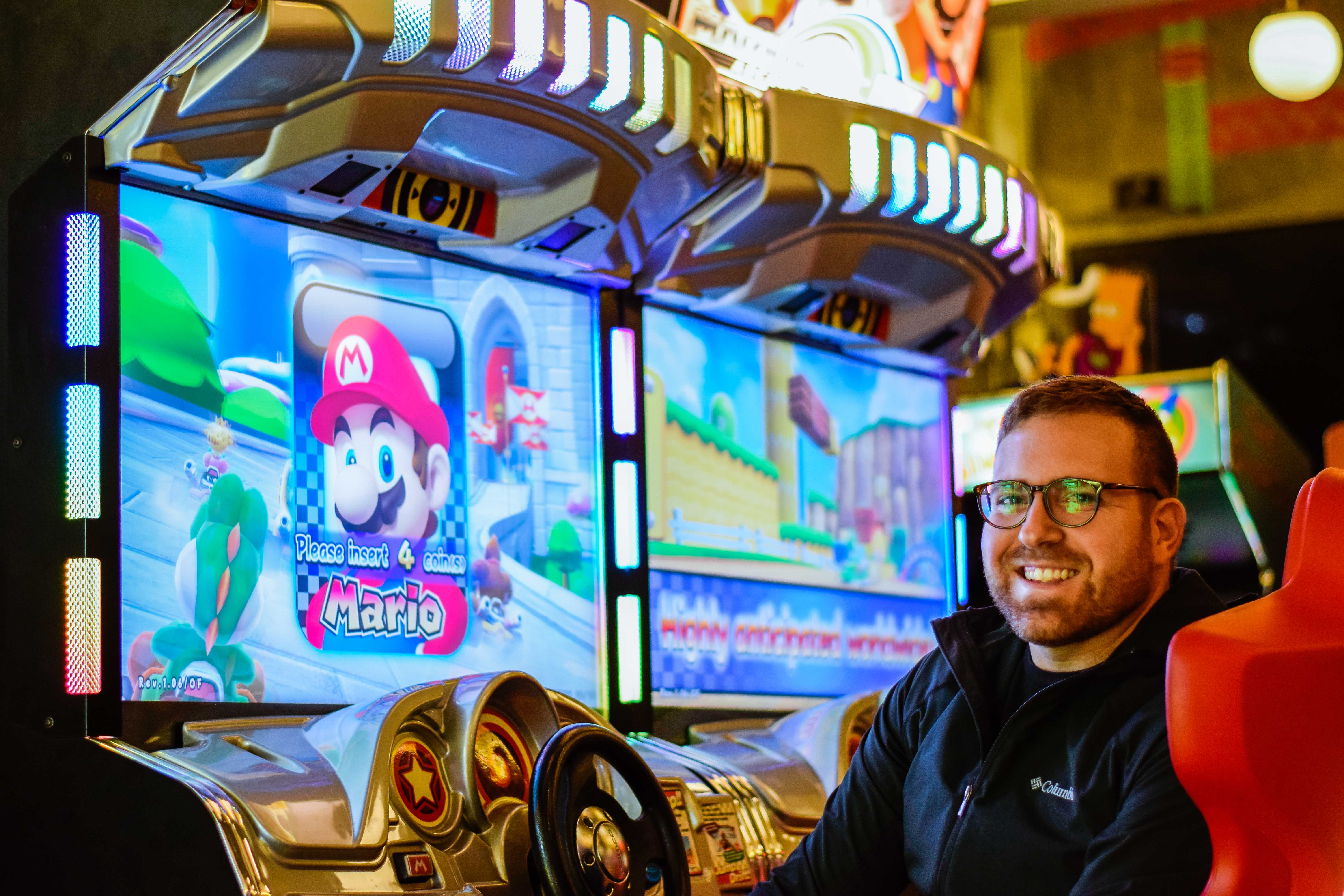 James DiSabatino relaxes in the chair of his favorite arcade game, Mario Kart, in the
