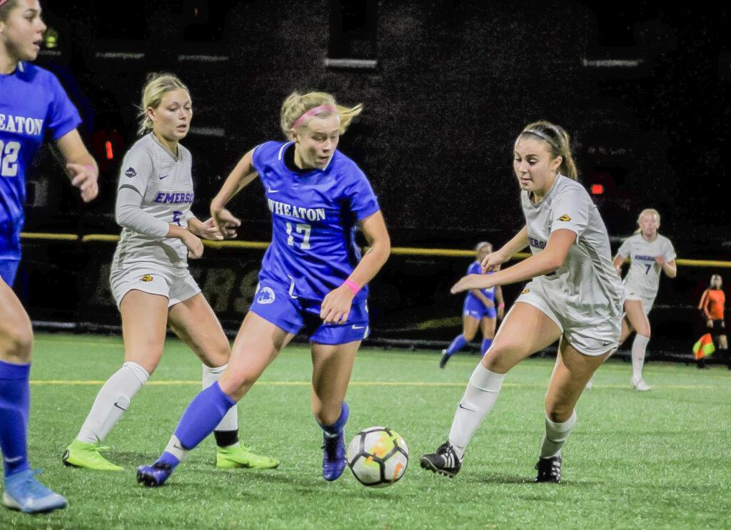 Freshman Sage Stack (right) battles a Wheaton College defender in a conference game on Oct. 15. Rachel Culver / Beacon Staff