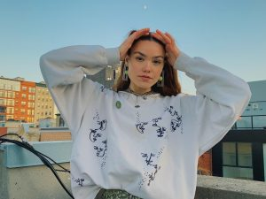 Junior's stained sweatshirt launches creative business