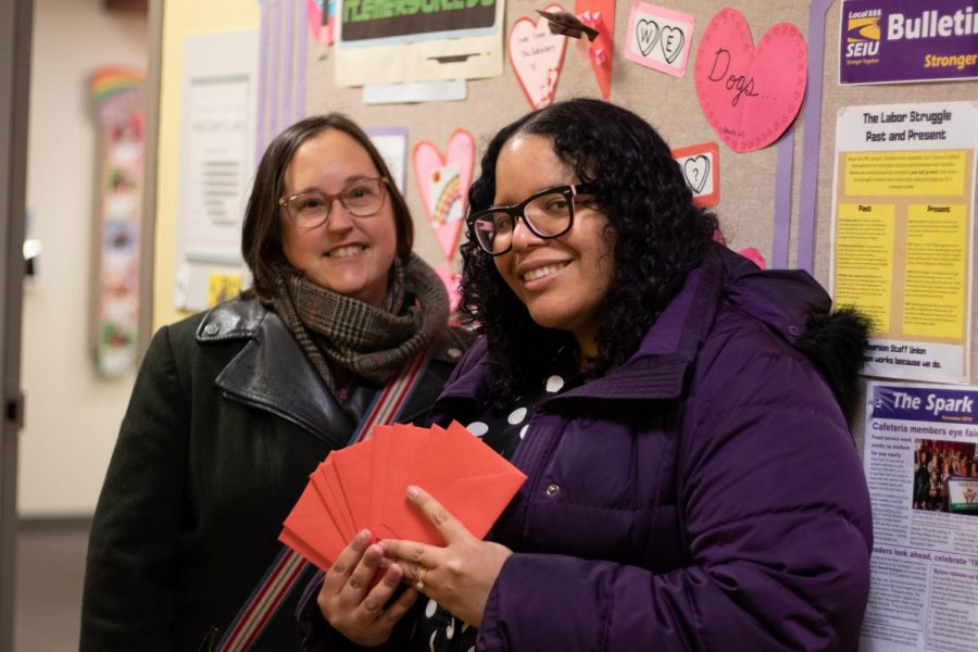 SEIU members hold up Valentine's cards inviting staff members to an event on Feb. 14. Tivara Tanudjaja