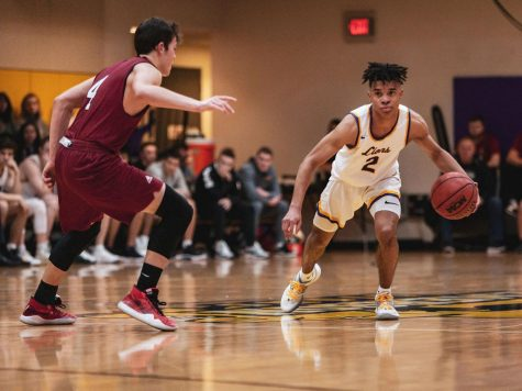Men's basketball dominates in home opener